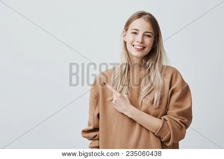 Check This Out Cropped Studio Shot Of Attractive Good-looking Smiling Young Woman In Casual Clothes