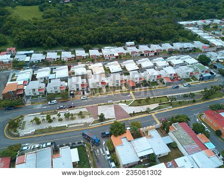 Street With Park In Residential Area Above View. Broadwalk Between Houses In Residential Area