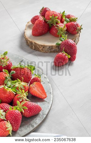 Plate Full Of Fresh Strawberries On Cement Background. Raw Strawberries. Fresh Strawberries With Cop