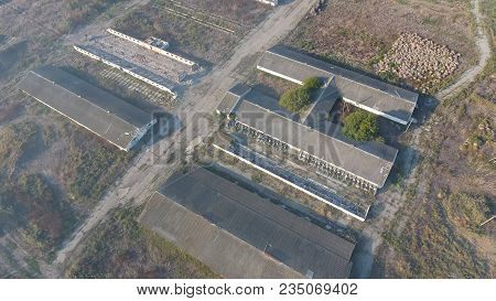 The Building Of An Old Farm For Cattle. Top View Of The Farm. Storage Of Bales Of Hay On The Old Far