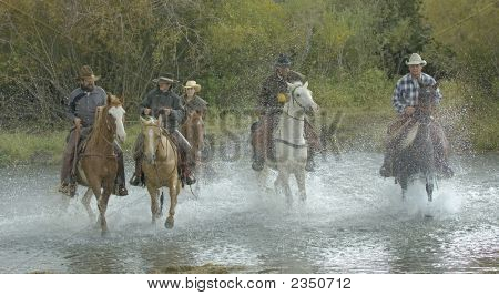Cowboys Galloping Across River