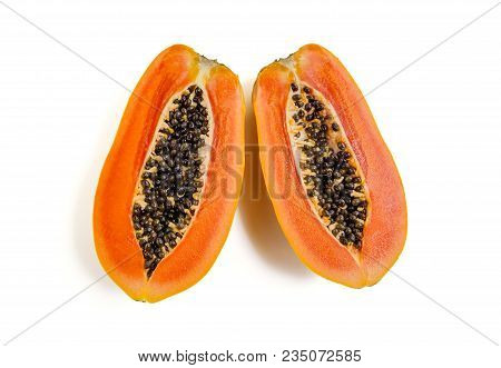 Top View Close Up Of Half Ripe Papaya Fruits Isolated On White Background. File Contains A Clipping