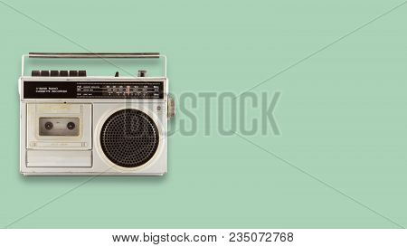 Radio Cassette Recorder And Player On Color Background. Retro Technology. Flat Lay, Top View Hero He