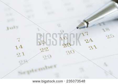 Simple Calendar With Days And Months, Focus On Dates And Pen. Closeup Numbers Shown Mix Color Dot Pr