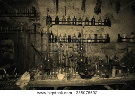 Old Laboratory Mining Tools And Measuring Devices. Bottles On Shelf In Old Pharmacy Laboratory. Old