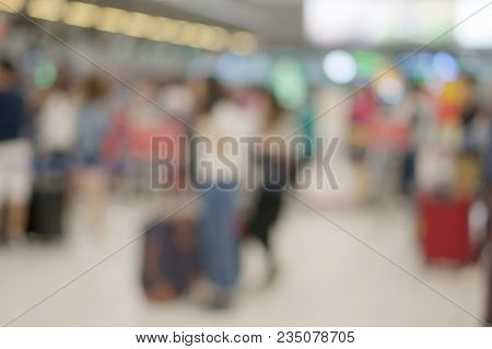 Abstract Blurred Tourist Waiting For Check In At Airport Terminal