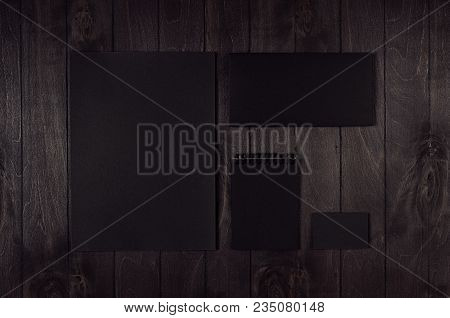 Blank Black Letterhead, Label, Envelope, Business Card On Dark Wood Board. Mock Up For Branding, Bus