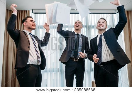 Winning Emotion And Papers In The Air. Successful Business Deal Or Contract Celebration. Company Man