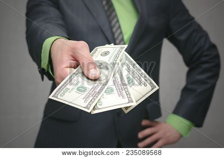 Business Man Holding In Hands Dollars Money. Give Money. Financial Help. Bank Loan. Business Success