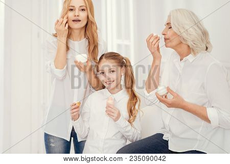 Skincare Treatment. Three Generations Of Women Sitting Next To Each Other While Spending Girly Time