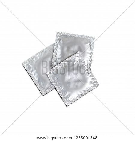 Three Condoms Isolated On White Background. Close Up.
