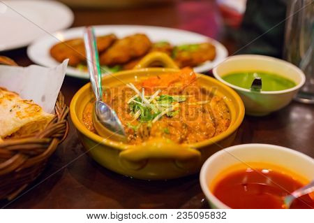 Closeup Of Massaman Curry Served On Table In Restaurant