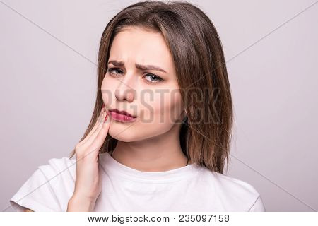 Teeth Problem. Woman Feeling Tooth Pain. Closeup Of A Beautiful Sad Girl Suffering From Strong Tooth