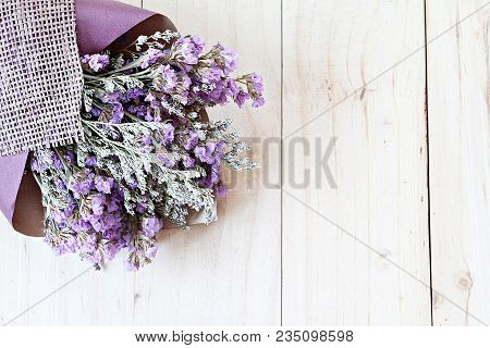 Nature Or Background Concept : Bouquet Of Dried Wild Flowers On Wooden Background With Copy Space, T