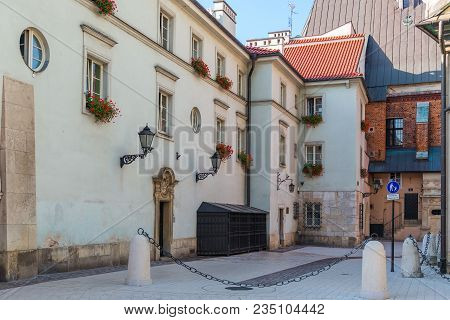 European Courtyard - A White House, The Windows Of Which Are Decorated With Flowers