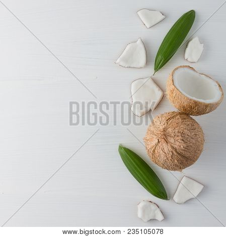 Tropical Fruit Whole And Half Abstract Background .coconut And Green Leaf On White Background. From