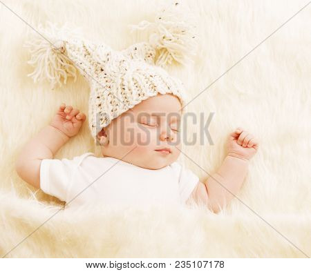 Baby Sleep, Newborn Kid In Woolen Hat Sleeping On White Fur Blanket, New Born Girl One Month Old
