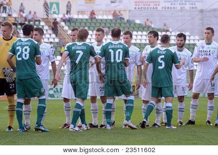 KAPOSVAR, HUNGARY - SEPTEMBER 10: Competitors shake hands before a Hungarian National Championship soccer game - Kaposvar (white) vs Gyor (green) on September 10, 2011 in Kaposvar, Hungary.