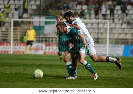 KAPOSVAR, HUNGARY - SEPTEMBER 10: Pedro Sass (white 33) in action at a Hungarian National Championship soccer game - Kaposvar (white) vs Gyor (green) on September 10, 2011 in Kaposvar, Hungary.