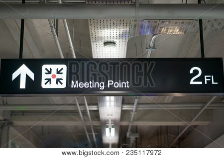 Meeting Point Information Board Sign At International Airport Terminal