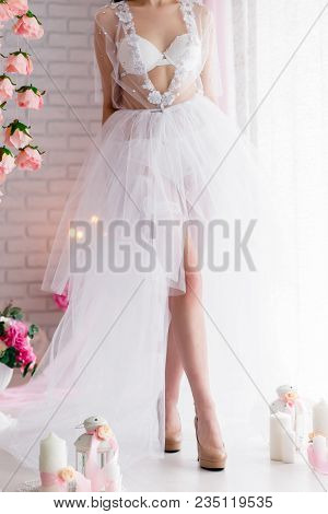 Attractive Young Woman In White Lingerie. Beautiful Bride In Lingerie In The Morning