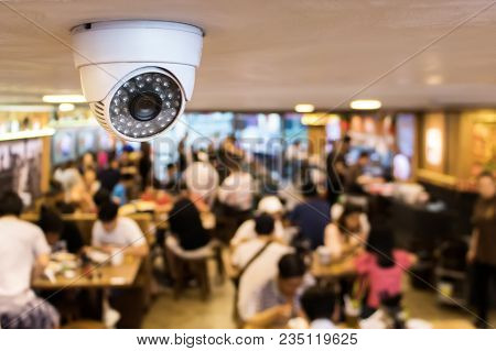 Cctv System Security Inside Of Restaurant.surveillance Camera Installed On Ceiling To Monitor For Pr
