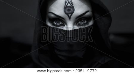 Beautiful Female Eyes. Assassin Woman With Covered Face. Smoky Eyes Makeup Close Up. Priestess Of Th