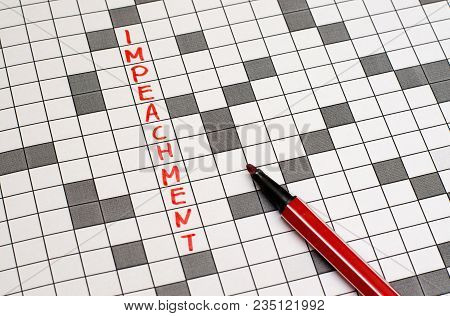 Impeachment. Text In Crossword. Red Letters. Close-up