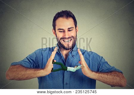 Conceptual Creative Shot Of A Man Between Hands Of A Laughing Smiling Guy Isolated On Gray Wall Back