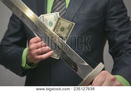 Businessman Holds In Hand A Toy Sword Weapon. Finance Insurance Agent. Money Deposite Safety Agent.