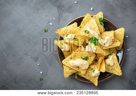 Nachos Chips And Melted Cheese. Tortilla Corn Mexican Nachos Chips In Bowl And Cheese Sauce Dip On G