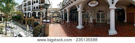Villamartin, Spain - April 7, 2018: Panoramic View Of Villamartin Plaza. Villamartin Plaza Lined Wit