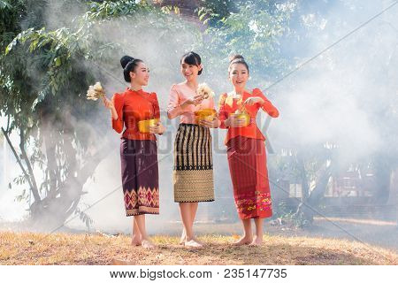 Beautiful Thai Girl In Thai Costume,asian Woman Wearing Traditional Thai Culture At Temple Playing W