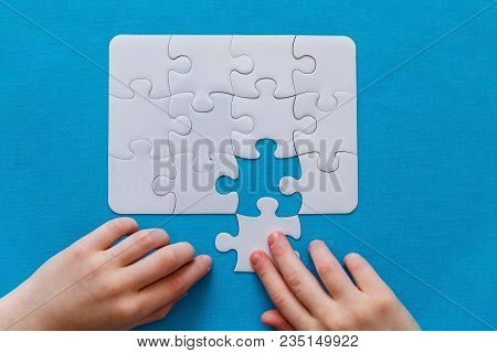 Last Piece Jigsaw In Hand,concept Success Of Business.