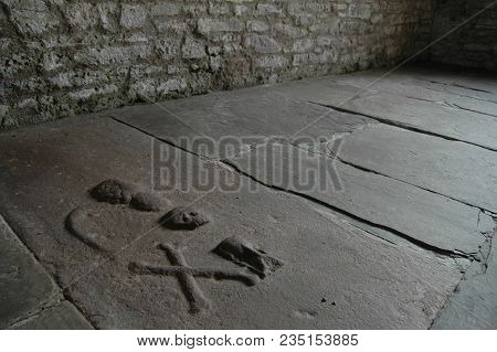 Markings On An Ancient Grave In A Chapel Floor, With Various Symbols Used.