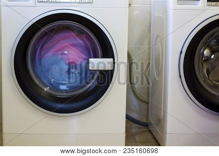 Colorful Clothes And Towels In Washing Machine