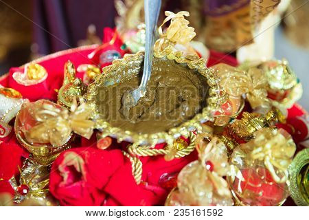 Mixing Henna For Hair. Natural Henna Color Mixed Pasted In A Bowl. Golden Decoration For The Henna .