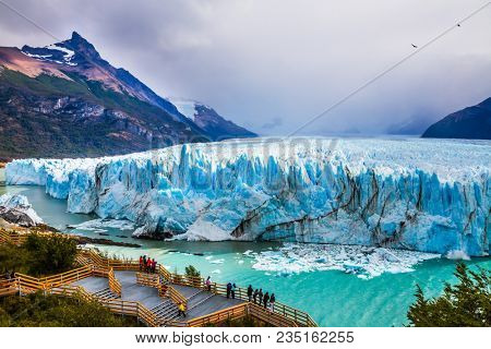 Grandiose glacier Perito Moreno in the Argentine part of Patagonia. The concept of ecological and extreme tourism. Large and comfortable observation deck for tourists