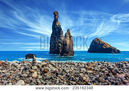Impressive trip to the fairy island. Warm summer day. Volcanic island of Madeira in the Atlantic Ocean. Three huge scenic rocks. Concept of exotic and ecological tourism
