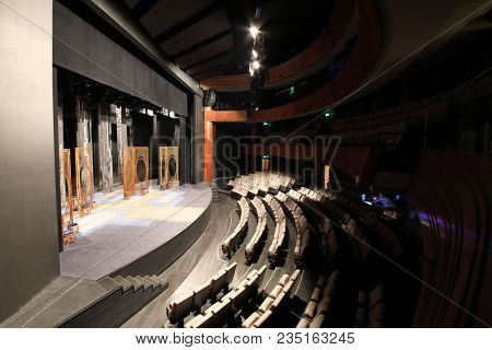 MOSCOW - SEP 14, 2017: Interior of an empty small hall with a stage with scenery and a hall with rows of chairs in the Moscow Theater Center Cherry Orchard