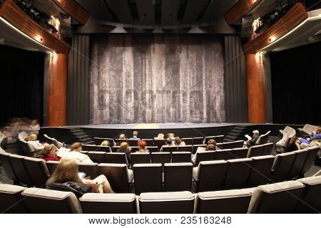 MOSCOW - SEP 14, 2017: The auditorium with a stage and a line of chairs with spectators awaiting the start of the performance in the Moscow Theater Center Cherry Orchard