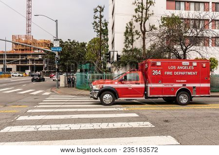 Los Angeles, Ca, Usa - April 5, 2018: Red Fire Department Rescue Van On Street Corner Of New High An