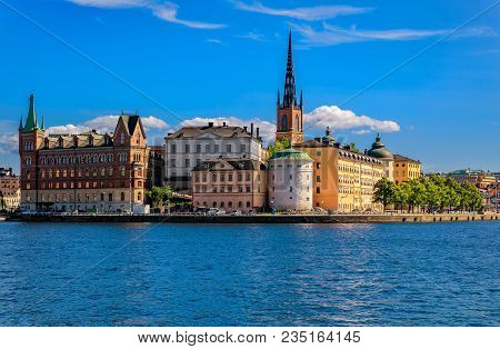 Stockholm, Sweden - August 17, 2017: View Across Lake Malaren Onto Traditional Gothic Buildings In T