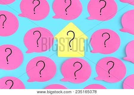 Stickers On A Blue Background. Pink Stickers With Question Marks. In The Center Is A Yellow Sticker