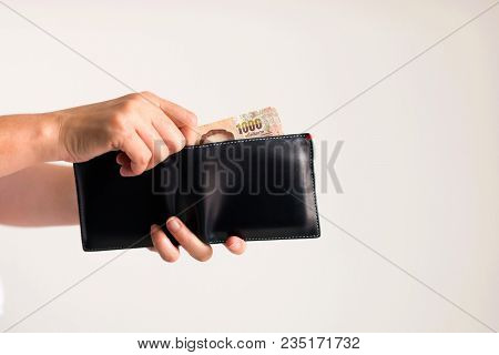 White Background Photo Of Hands Holding A Wallet And Another Hand Bring Thai Money From It To Pay Fo
