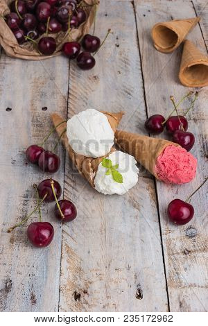 Traditional Waffle Cones For Ice Cream On Wooden Table. Cherry Ice Cream And Fresh Cherries. Cones F