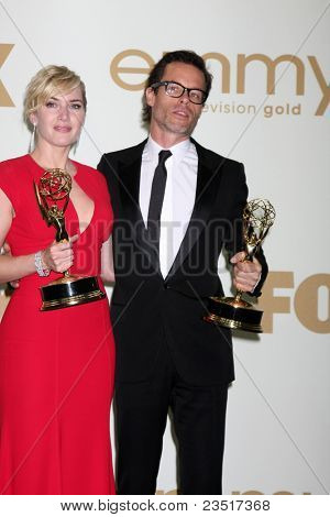 LOS ANGELES - SEP 18:  Kate Winslet, Guy Pearce in the Press Room at the 63rd Primetime Emmy Awards at Nokia Theater on September 18, 2011 in Los Angeles, CA
