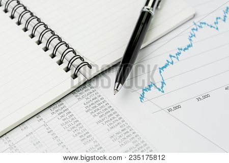 Business Perfomance Review, Budget, Economics Or Investment Concept, Pen On Note Book With Graph And