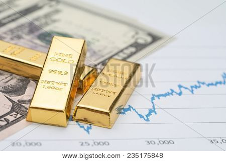 Gold Bullion Ingot Stack On America Us Dollar Banknote Money And Rising Price Graph As Crisis Safe H