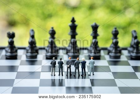 Unity And Teamwork In Business Strategy Concept, Group Of Miniature People Businessmen Collaborate H